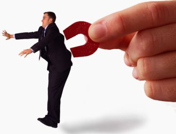 Magnet Grabbing Businessman